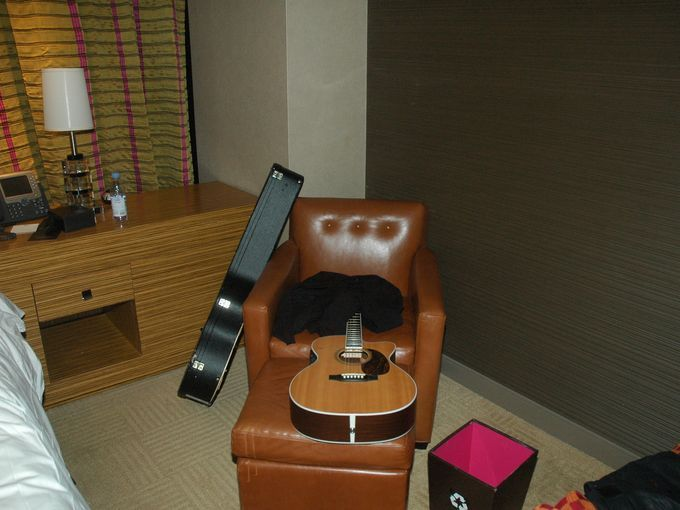 Chris Cornell's acoustic guitar lies on a chair in his hotel room