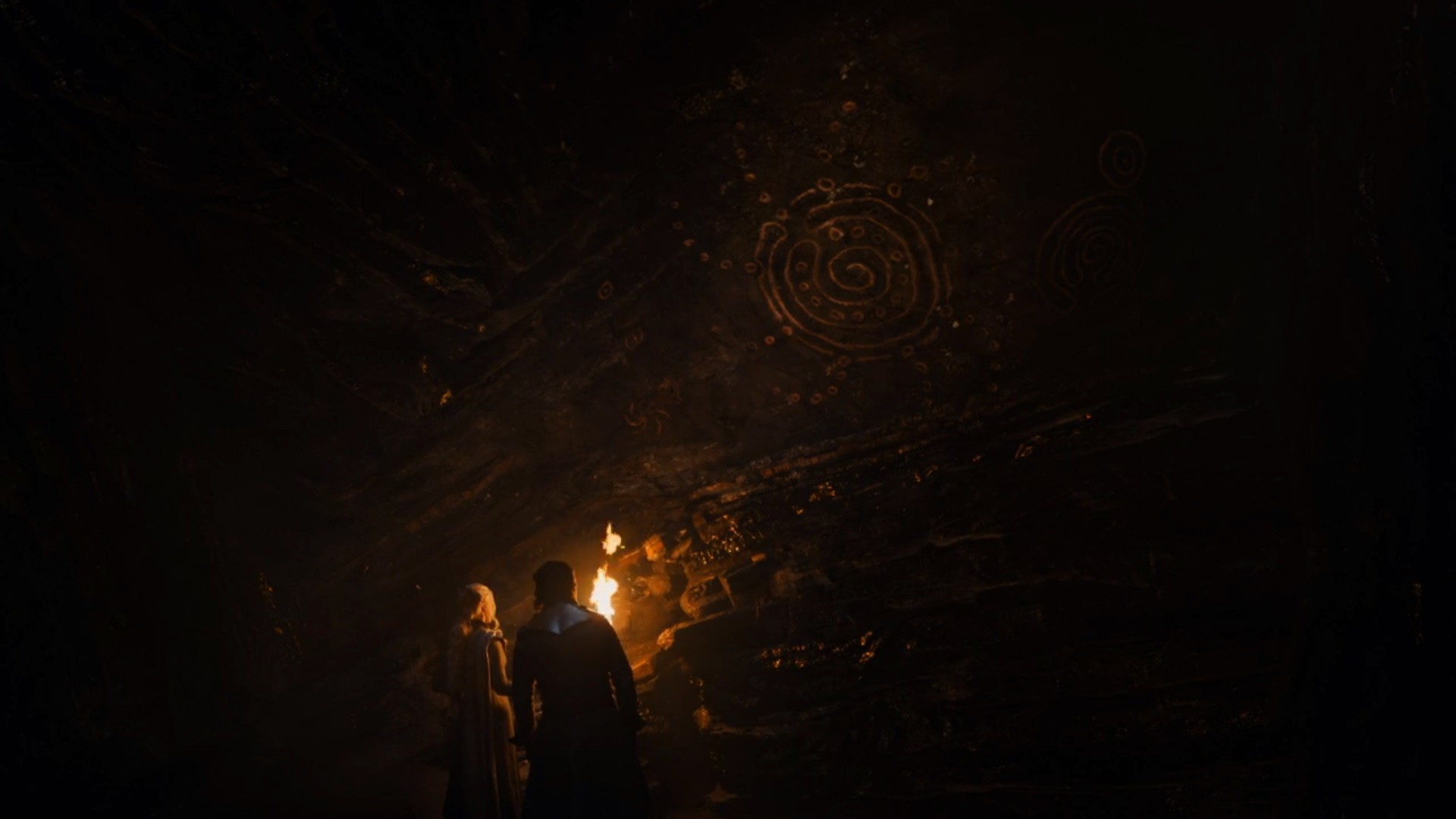 Jon Snow and Daenerys Targaryen in the caves under Dragonstone with the drawings of the Children of the Forest